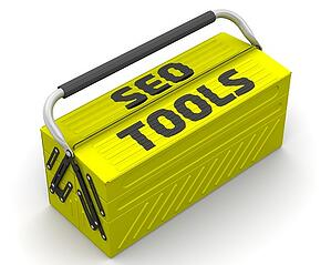 A bright yellow toolbox with a black handle is labeled SEO tools